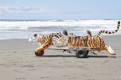 Shaun Walker/The Times-Standard  Sara and Tess Krause of Eureka pedal Tiger and Amazons down Manila Beach at the Kinetic Grand Championship on Saturday.
