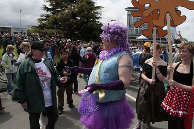 Shaun Walker/The Times-Standard  Rutabaga Princess Berry Picker, aka, John Post, hands out candy at the Kinetic Grand Championship on Saturday.