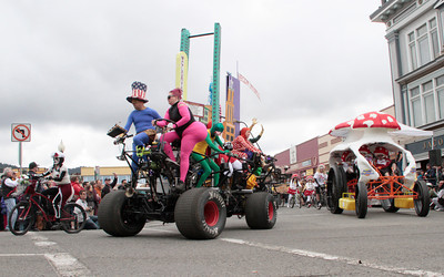 Shaun Walker/The Times-Standard  Heroes of Gloryopolis pedal past Attack of the Funguys at the Kinetic Grand Championship on Saturday.