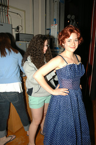 "Emily Walton zips up Lily Holgate's dress between scenes at dress rehersal of ""Bells are Ringing"" photo by Tony Bucca"
