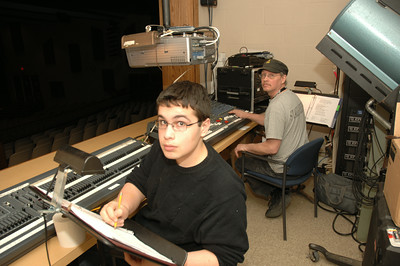 "Isaac Banner and Scott Walrath work the lighting and effects booth at ""Bells are Ringing"" at Saratoga High school. photo by Tony Bucca"