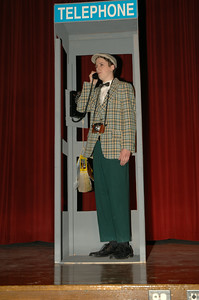 "Jack Curran makes a phone-call in ""Bells are Ringing"" at Saratoga High School. photo by Tony Bucca"