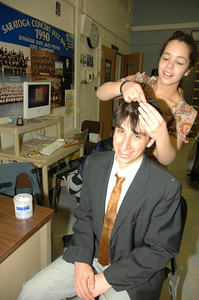 "Conor Arpey gets his hair slicked back by Evy Yergan backstage at rehersal for ""Bells are Ringing"" photo by Tony Bucca"