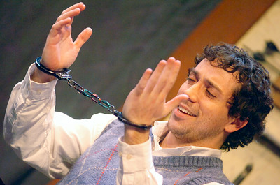 Clifford Anderson, played by Ian LaChance, plays with the magic Houdini handcuffs  during their dress rehearsal of Deathtrap, as part of the HMT at the Spa Little Theater. Photo Erica Miller 2/8/10 fea_Deathtrap2