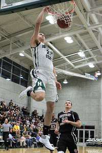 Josh Jackson/The Times-Standard  Jacks' Kyle Baxter dunks during Friday's game in Arcata.