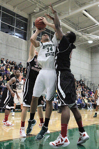 Josh Jackson/The Times-Standard  Jacks' Tavin Hurley shoots under pressure during Friday's game in Arcata.