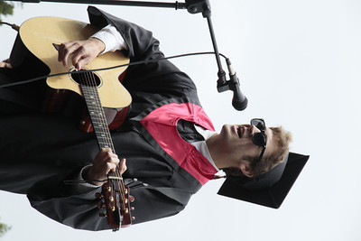 Shaun Walker/The Times-Standard  Tyler Coley sings at McKinleyville High School's graduation ceremony at College of the Redwoods on Thursday afternoon. About 150 seniors graduated.