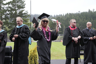 Shaun Walker/The Times-Standard  Holly Eve Adams celebrates after getting her diploma at McKinleyville High School's graduation ceremony at College of the Redwoods on Thursday afternoon. About 150 seniors graduated.