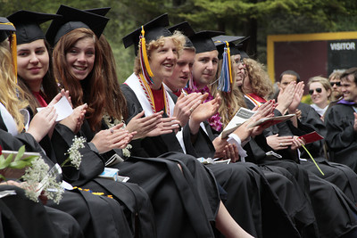 Shaun Walker/The Times-Standard  Seniors clap during McKinleyville High School's graduation ceremony at College of the Redwoods on Thursday afternoon. About 150 seniors graduated.