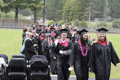 Shaun Walker/The Times-Standard  Seniors walk into at McKinleyville High School's graduation ceremony at College of the Redwoods on Thursday afternoon. About 150 seniors graduated.
