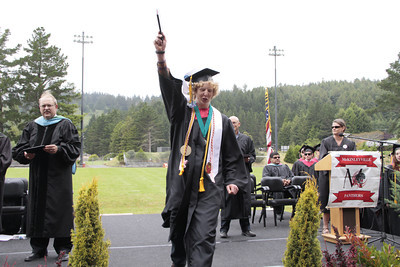 Shaun Walker/The Times-Standard  Travis Kent Bullock celebrates after getting his diploma at McKinleyville High School's graduation ceremony at College of the Redwoods on Thursday afternoon. About 150 seniors graduated.