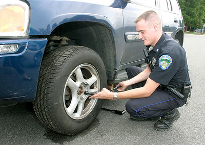Vernon Officer Changes Tire