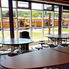 The Brattleboro Area Middle School cafeteria looks out on school buses waiting for students Tuesday. (Jason R. Henske/Reformer)