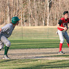 Kerri Fleming/Reformer<br /> Leland & Gray's Gabe Pozzi leans toward home while being held by Twin Valley third baseman Ryan Dix in Thursday's game in Townshend. Leland & Gray won, 6-0.