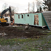 Zachary P. Stephens/Reformer<br /> Workers from Gene Armstong Excavating remove the damaged mobile homes from Glen Park in West Brattleboro, Thursday morning.<br /> The mobile homes were severely damaged by the flooding of the Whetstone Brook during Tropical Storm Irene.