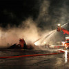 Zachary P. Stephens/Reformer<br /> Smoke rises from the remains of the Putney General Store after a fire late Sunday night.