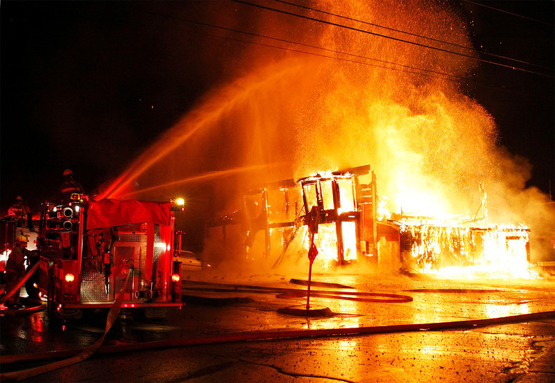 Zachary P. Stephens/Reformer<br /> Firefighters respond to a four alarm fire at the Putney General Store late Sunday night.