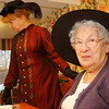 Right, Alane Perkins of Newfane, dressed in victorian garb entertains Persis Stillson, left, and other residents of the Holton Home in Brattleboro, Friday afternoon during a victorian tea party.<br /> (Zachary P. Stephens/Reformer)
