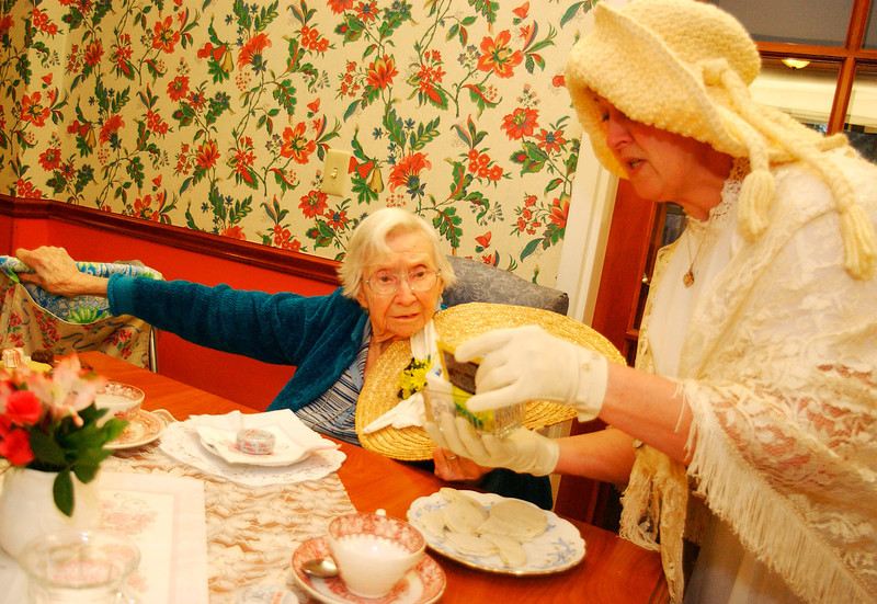 Right, Margo Langlois of Brattleboro serves Marjorie Odette some tea, during a victorian tea party at the Holton Home in Brattleboro, Friday afternoon.<br /> (Zachary P. Stephens/Reformer)