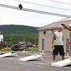 At far right, Dave Icardi tosses a large bean bag as part of a corn hole tournament at Bass Water Grill in Cheshire.  There will be another tournament August 22nd benefitting the Lions Club of Cheshire.  Cheshire, 7/25/10 - Ian Grey