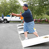 Andy Kachel participates in a corn hole tournament at Bass Water Grill in Cheshire.  There will be another tournament August 22nd benefitting the Lions Club of Cheshire.  Cheshire, 7/25/10 - Ian Grey