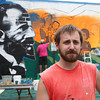 Local artist Brett Parson in front of the W.E.B. DuBois mural in Great Barrington on Sunday.  Great Barrington, 7/25/10 - Ian Grey