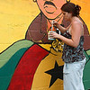 Melissa Hodges, a UMass grad student, applies a finishing coat of paint to Dr. Martin Luther King Jr., who is part of the W.E.B. DuBois mural in Great Barrington.  Great Barrington, 7/25/10 - Ian Grey