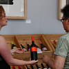 Caitlin Harrison of The Market on North Street helps advise Ann Tabachnikov on wine selection during a wine and cheese tasting on Saturday afternoon.  Pittsfield, 7/3/10 - Ian Grey