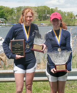 Loudonville Christian's Morgan Lansing, left, and Casey Stein hold onto their NYS championship club lightweight double awards Sunday. STAN HUDY/Community News