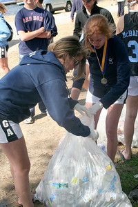 Saratoga Rowing's Taylor Murray (left) and Morgan Lansing separate plastic bottles for recycling Sunday afternoon, both after winning gold medals at the state championhips. STAN HUDY/Community News