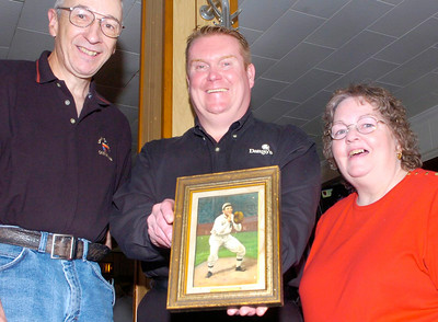 """Dango"" Dave Johnson holds a rare print of major leaguer Ira Thomas, a Ballston Spa native who played baseball in the early 1900's, which he gave to Thomas' relative Cathy King Eddy, left, of New Britain, Connecticutt on Tuesday. Eddy traveled to South Glens Falls with husband Chuck to pick it up at Abbott's Corner Grill, one of several restaurants Johnson runs in the area. Ed Burke 4/28/09"