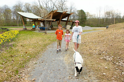 Greenwich resident Jennifer Carey with daughter Zoe and son Ethan walk their dog Tuesday evening at Hudson Crossing Park in Schuylerville. The educational park under construction near Champlain Canal Lock 5 is taking shape with the erection of a picnic pavilion and children's play area to compliment the nature trail along the canal. Future plans include an educational center. Ed Burke 4/28/09
