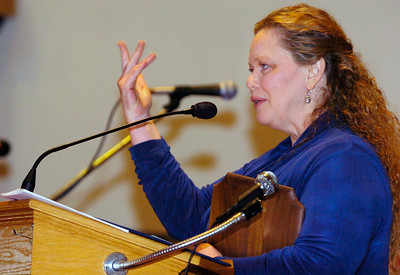 Public Service Award recipient Maggie Fronk, of Domestic Violence and Rape Crisis Services in Saratoga County, thanks the audience for all the help that has been brought to the issues of domestic violence. Fronk received the award during Sunday's 10th annual candlelight vigil at Presbyterian-New England Congregational Church. The event commenced the local observance of National Crime Victims' Rights Week.  Photo Erica Miller 4/26/09 news_Vigil1_Mon