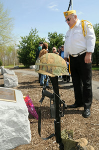 At the Saratoga National Cemetery, Jerry Pouliott of Saratoga Springs takes a moment to reflect during Thursdays ceremony at the dedicated plaque marking the 30th anniversary of the fall of Saigon. photo Rick Gargiulo news_saigon1_fri 4/30/09