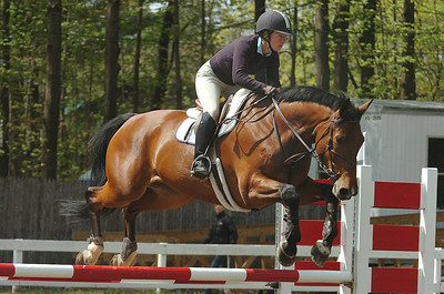 Jordina Thorp aboard Donald VanDeKolman is suspended in air over one of the jumps at the St. Clement's Horse Show at the Yaddo grounds on Union Ave. The show runs until May 3.  photo Rick Gargiulo news_horseshow1_thu 4/29/09