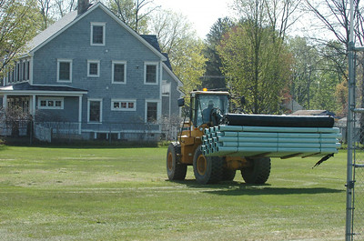 A construction loader places water pipes on the grounds of the South Side Rec property Thursday afternoon. photo Rick Gargiulo news_southside_fri 4/30/09