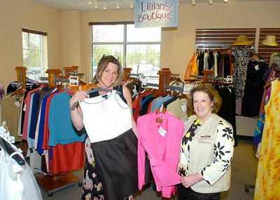 Sales associate Lori Scena, left, and hospital guild volunteer Kate Calbone display clothing available at the recently opened Treasures Consignment and Thrift store at 60 West Ave. The new business is operated by the Saratoga Hospital Volunteer Guild. Ed Burke 4/30/09