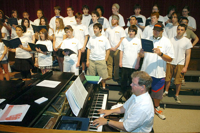 With Music teacher Jeffery Halstead playing piano, with the Saratoga Springs High School choraliers  during a practice rehearsal Monday morning. photo Rick Gargiulo news_song1_tue 4/27/09