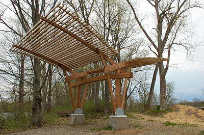 A sculpture installation spreads wings of wood above the nature trail at Hudson Crossing Park in Schuylerville. Ed Burke 4/28/09