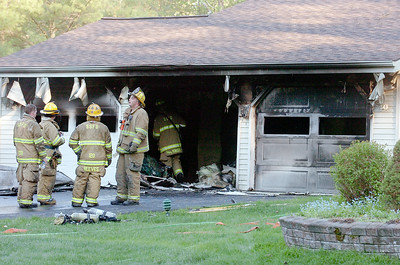 Fire on Leaward Way in Knoll Spring Park where a motorcycle caught on fire in their garage. Photo Erica Miller 5/3/10 news_GarageFire_Tues