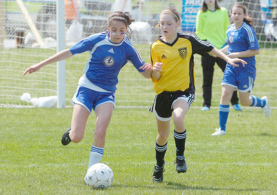 Maddison Feeley of Saratoga Strikers U14B team battles with Megan Robinson of the Clifton Park Dragons during action Saturday at Gavin Park in Wilton. Ed Burke 5/1/10