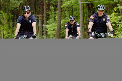 Saratoga Springs Police Mountain Bike Department DARE officer Tony Straus, right, led the way through Saratoga State Park with Dan Mullan Jr (left), Ed Braim (back) and Adam Baker (not shown) for their refresher bicycle training Monday morning. Photo Erica Miller 5/4/10 news_BikeTrain2_Wed