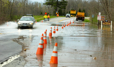 Cars drive down Route 4 just moments before they close the road as the Hudson River rose to rapid heights as flooding occurred for the second day. Photo Erica Miller 4/29/11 news_Flooding9_Sat