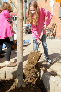Malta Ave Elementary fifth grader Sarah Aldrich dumps dirt into the new leveland Select Pear Pyrus Calleryana tree planted on the corner of Malta Ave and Milton Ave in celebration of Arbor Day and cleaning the streets of Ballston Spa. Photo Erica Miller 4/29/11 news_ElemPlant2_Sat