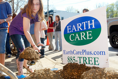 Malta Ave Elementary fifth grader Kate Wheeler digs up dirt to put into the new Cleveland Select Pear Pyrus Calleryana tree planted on the corner of Malta Ave and Milton Ave in celebration of Arbor Day and cleaning the streets of Ballston Spa. Photo Erica Miller 4/29/11 news_ElemPlant3_Sat