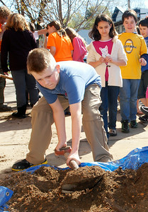 Malta Ave Elementary fifth grader Dylan Dutkiewicz digs up dirt to put into the new Cleveland Select Pear Pyrus Calleryana tree planted on the corner of Malta Ave and Milton Ave in celebration of Arbor Day and cleaning the streets of Ballston Spa. Photo Erica Miller 4/29/11 news_ElemPlant4_Sat