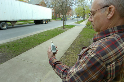 "Van Dam St. resident Les Jackson measures decibles of noise from truck traffic in front of his home Friday. Jackson objects to the use of ""Jake brakes"" which increase the decibles dramatically. Most trucks on Friday weren't using the controversial brakes and registering around eighty decibles with one spiking to eighty eight decibles. Ed Burke 4/29/11"