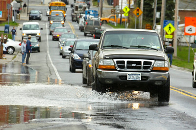 A truck drive down Route 4 just moments before they close the road as the Hudson River rose to rapid heights as flooding occurred for the second day. Photo Erica Miller 4/29/11 news_Flooding10_Sat