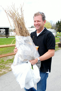"Jim Cassico, of Diamond Point, carries his seedlings of roses, vinca and pachysandra to his car that he pre-ordered at the annual seedling distribution at the Saratoga County Fairgrounds, which continues through today 9 a.m. - 3 p.m. (Saturday 4/30). Cassico said ""this is the best place to get them."" Photo Erica Miller 4/29/11 news_Seedlings2_Sat"