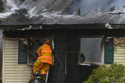 Fire Departments from Milton, Greenfield, Rock City Falls work on a structure fire on Route 29 mid-afternoon on Monday. The residents of the home were safely evacuated. Photo Erica Miller 4/30/12 news_Fire5_Tues